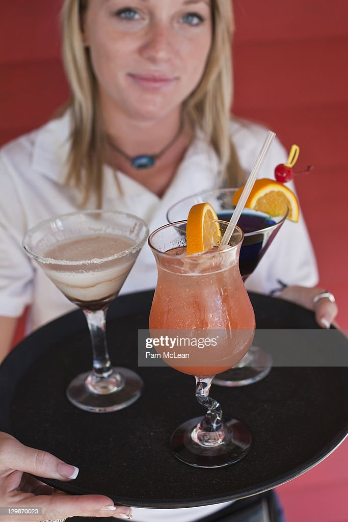 Waitress with tray of tropical beverages : Stock Photo