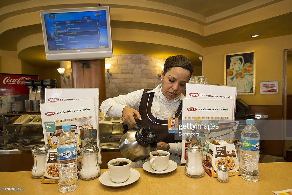Waitress Yolanda Aceves pours coffee at a Vips restaurant in the El Toreo neighborhood of Mexico City, Mexico, on Monday, June 17, 2013. Wal-Mart de Mexico SAB de CV, known as Walmex, is considering offers to sell its restaurant division, which includes the Vips, El Porton, Ragazzi and La Finca brands. Photographer: Susana Gonzalez/Bloomberg via Getty Images