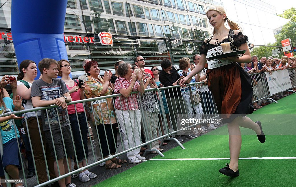 A waitresses crosses the finish line with a latte macchiato coffee drink during the Waiters' Derby (Kellner Derby in German) on August 4, 2013 in Berlin, Germany. At the annual event, brought back into existence in 2011 on the 125th anniversary of the Kurfuerstendamm (known locally as the Ku'damm), a main shopping thoroughfare, waiters, porters, cooks and bartenders run a 400-meter track while performing their regular occupational duties. The event was reinstated after a hiatus since the 1950s, when it was created to bring a sense of normal life back to Berlin after World War II under the Allies, a period in which gastronomical interest in the isolated Western part of the city suffered.