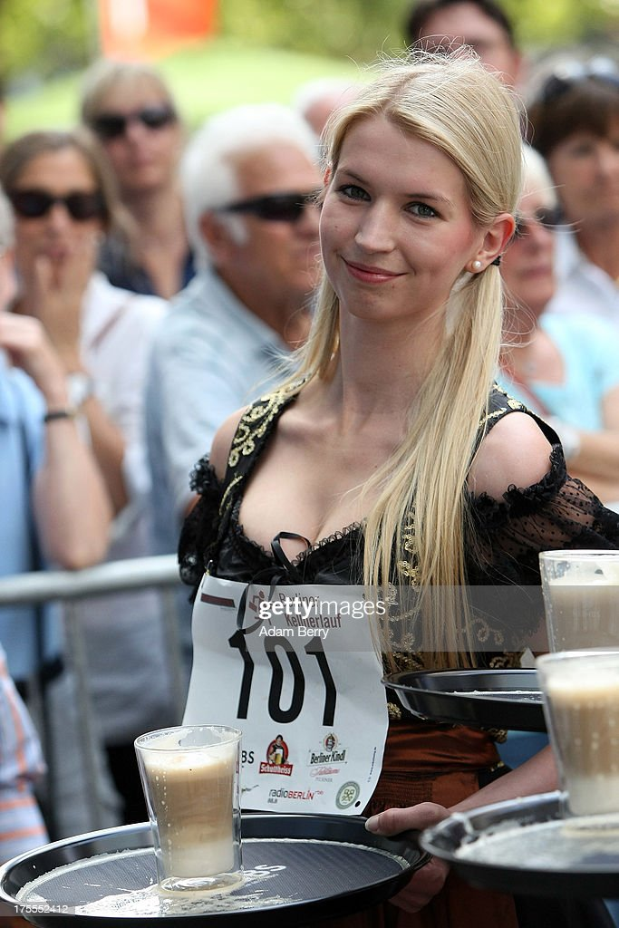 A waitresses holding a tray with a latte macchiato coffee drink pauses after running during the Waiters' Derby (Kellner Derby in German) on August 4, 2013 in Berlin, Germany. At the annual event, brought back into existence in 2011 on the 125th anniversary of the Kurfuerstendamm (known locally as the Ku'damm), a main shopping thoroughfare, waiters, porters, cooks and bartenders run a 400-meter track while performing their regular occupational duties. The event was reinstated after a hiatus since the 1950s, when it was created to bring a sense of normal life back to Berlin after World War II under the Allies, a period in which gastronomical interest in the isolated Western part of the city suffered.
