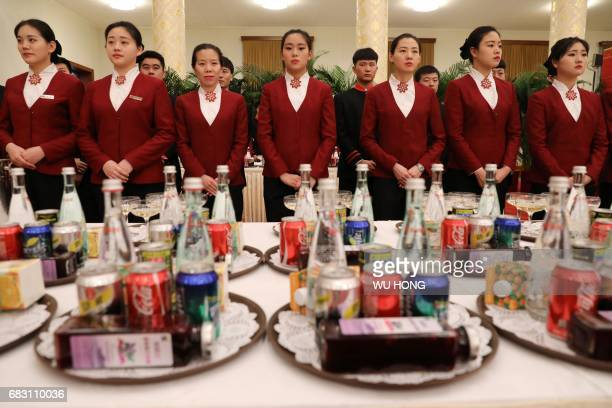 Waitresses prepare to serve at a welcome banquet for the Belt and Road Forum at the Great Hall of the People in Beijing on May 14 2017 HONG