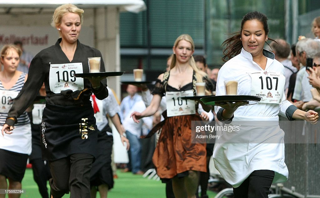 Waitresses run with a latte macchiato coffee drinks during the Waiters' Derby (Kellner Derby in German) on August 4, 2013 in Berlin, Germany. At the annual event, brought back into existence in 2011 on the 125th anniversary of the Kurfuerstendamm (known locally as the Ku'damm), a main shopping thoroughfare, waiters, porters, cooks and bartenders run a 400-meter track while performing their regular occupational duties. The event was reinstated after a hiatus since the 1950s, when it was created to bring a sense of normal life back to Berlin after World War II under the Allies, a period in which gastronomical interest in the isolated Western part of the city suffered.