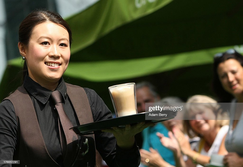 A waitresses runs with a latte macchiato coffee drink during the Waiters' Derby (Kellner Derby in German) on August 4, 2013 in Berlin, Germany. At the annual event, brought back into existence in 2011 on the 125th anniversary of the Kurfuerstendamm (known locally as the Ku'damm), a main shopping thoroughfare, waiters, porters, cooks and bartenders run a 400-meter track while performing their regular occupational duties. The event was reinstated after a hiatus since the 1950s, when it was created to bring a sense of normal life back to Berlin after World War II under the Allies, a period in which gastronomical interest in the isolated Western part of the city suffered.