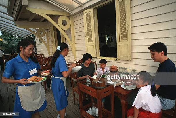 Waitresses serve a family their lunch at the BanKlangNam restaurant The restaurant sits on the bank of Chao Phraya River The restaurant specializes...