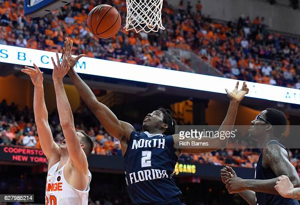 Wajid Aminu of the North Florida Ospreys reaches to control a rebound over Tyler Lydon of the Syracuse Orange during the second half at the Carrier...