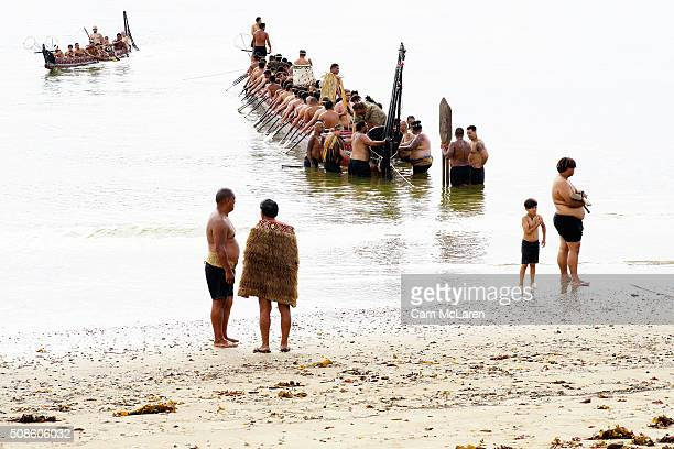 Waka are welcomed to the beech on February 6 2016 in Waitangi New Zealand The Waitangi Day national holiday celebrates the signing of the treaty of...