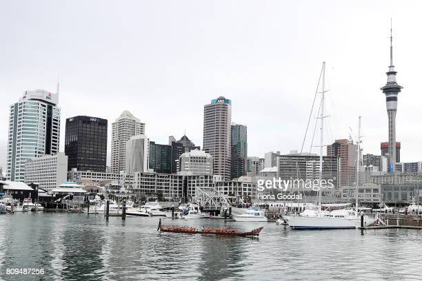A waka enters the Viaduct Basin during the Team New Zealand Americas Cup Welcome Home Parade on July 6 2017 in Auckland New Zealand