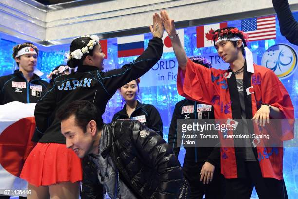 Wakaba Higuchi of Japan celebrates with her team mates at kiss and cry after the Ladies free skating during the 3rd day of the ISU World Team Trophy...
