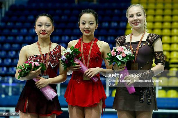 Wakaba Higuchi of Japan presents her silver medalm Marin Honda of Japan presents her gold medal and Diana Pervushkina of Russia presents her bronze...