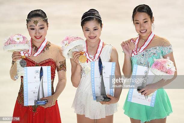 Wakaba Higuchi Satoko Miyahara and Mai Mihara of Japan pose with their medals after the Ladies free skating during the Japan Figure Skating...