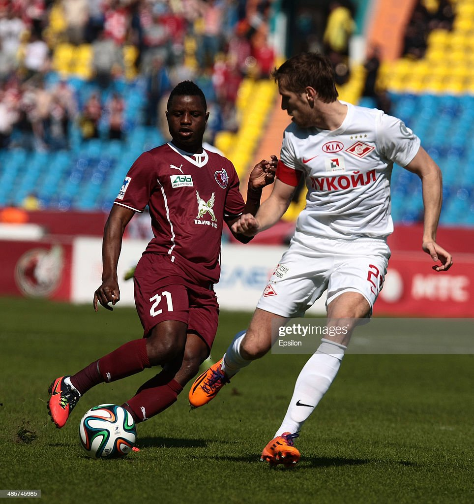 <a gi-track='captionPersonalityLinkClicked' href=/galleries/search?phrase=Wakaso+Mubarak&family=editorial&specificpeople=7523524 ng-click='$event.stopPropagation()'>Wakaso Mubarak</a> (L) of FC Rubin Kazan is challenged by <a gi-track='captionPersonalityLinkClicked' href=/galleries/search?phrase=Dmitri+Kombarov&family=editorial&specificpeople=1043615 ng-click='$event.stopPropagation()'>Dmitri Kombarov</a> of FC Spartak Moscow during the Russian Football League Championship match between FC Rubin Kazan and FC Spartak Moscow at the Tsentraliniy Stadium on April 20, 2014 in Kazan, Russia.