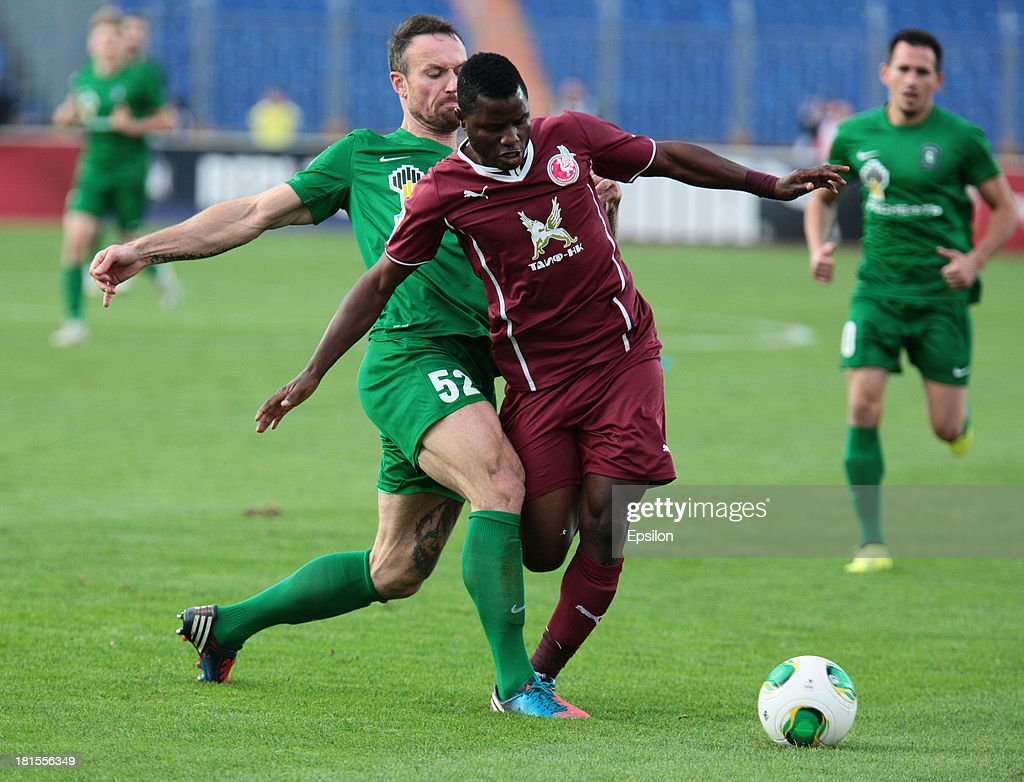 <a gi-track='captionPersonalityLinkClicked' href=/galleries/search?phrase=Wakaso+Mubarak&family=editorial&specificpeople=7523524 ng-click='$event.stopPropagation()'>Wakaso Mubarak</a> (R) of FC Rubin Kazan is challenged by Martin Jiranek of FC Tom Tomsk during the Russian Premier League match between FC Rubin Kazan and FC Tom Tomsk at the Tsentraliniy Stadium on September 22, 2013 in Kazan, Russia.