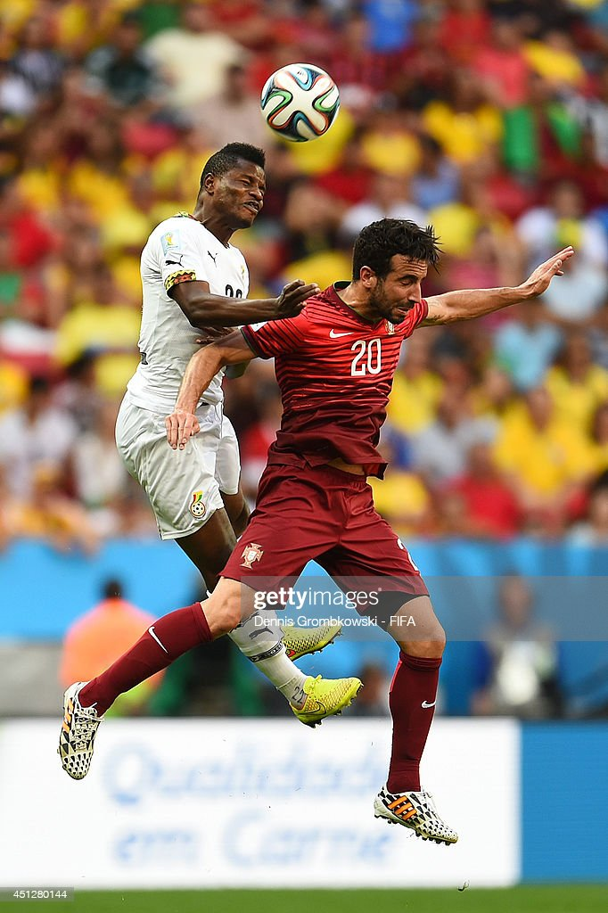 <a gi-track='captionPersonalityLinkClicked' href=/galleries/search?phrase=Wakaso+Mubarak&family=editorial&specificpeople=7523524 ng-click='$event.stopPropagation()'>Wakaso Mubarak</a> of Ghana and Ruben Amorim of Portugal compete for the ball during the 2014 FIFA World Cup Brazil Group G match between Portugal and Ghana at Estadio Nacional on June 26, 2014 in Brasilia, Brazil.
