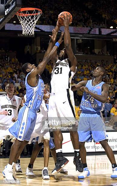 Wake Forest center Eric Williams goes up strong to the basket betwen North Carolina guard Jackie Manuel and forward Marvin Williams Wake Forest...