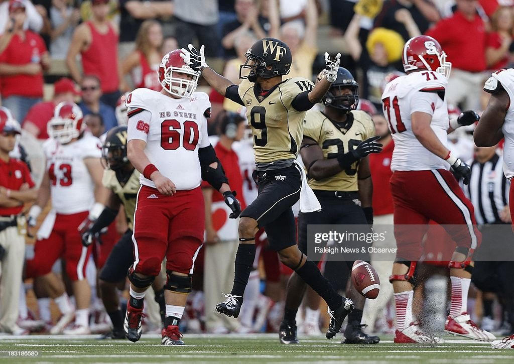 Wake Forest cornerback Kevin Johnson (9) celebrates after intercepting a North Carolina State pass at the Wake Forest 7-yard line during the second half at BB&T Field in Winston-Salem, North Carolina, on Saturday, October 5, 2013. Wake Forest won, 28-13.
