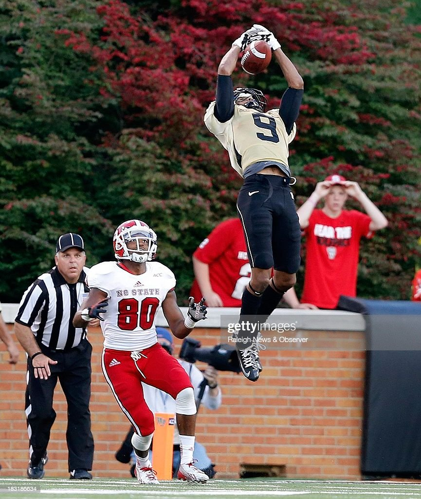 Wake Forest cornerback Kevin Johnson (9) intercepts a pass intended for North Carolina State wide receiver Bryan Underwood (80) during the second half at BB&T Field in Winston-Salem, North Carolina, on Saturday, October 5, 2013. Wake Forest won, 28-13.
