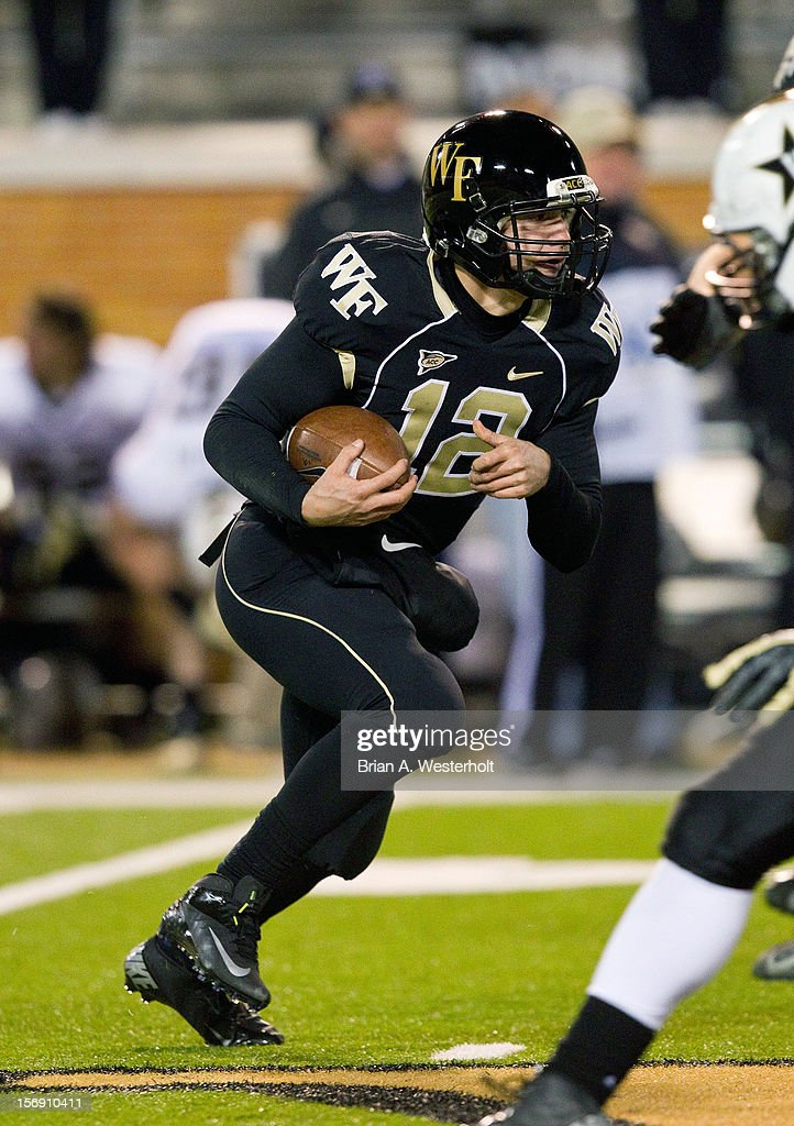 Wake Forest Demon Deacons quarterback Brendan Cross #12 looks for running room during fourth quarter action against the Vanderbilt Commodores at BB&T Field on November 24, 2012 in Winston Salem, North Carolina. The Commodores defeated the Demon Deacons 55-21.