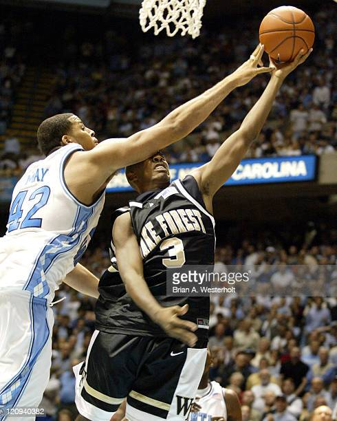 Wake Forest guard Chris Paul is fouled by North Carolina center Sean May during the second half of the Demon Deacons 3 overtime 119114 defeat of the...
