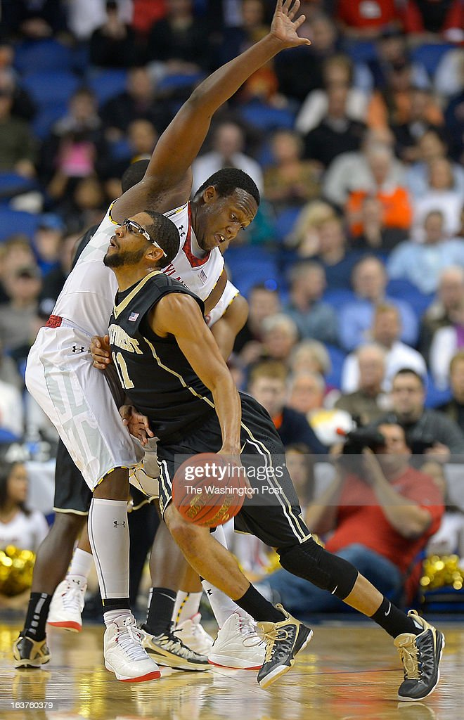 Wake Forest guard <a gi-track='captionPersonalityLinkClicked' href=/galleries/search?phrase=C.J.+Harris+-+Basketballer&family=editorial&specificpeople=12527142 ng-click='$event.stopPropagation()'>C.J. Harris</a> (11), left, plows into Maryland Terrapins forward Charles Mitchell (0) as the Maryland Terrapins defeat the Wake Forrest Demon Deacons 75 - 62 in the first round of the ACC mens basketball tournament at the Greensboro Coliseum in Greensboro NC, March 14, 2013.