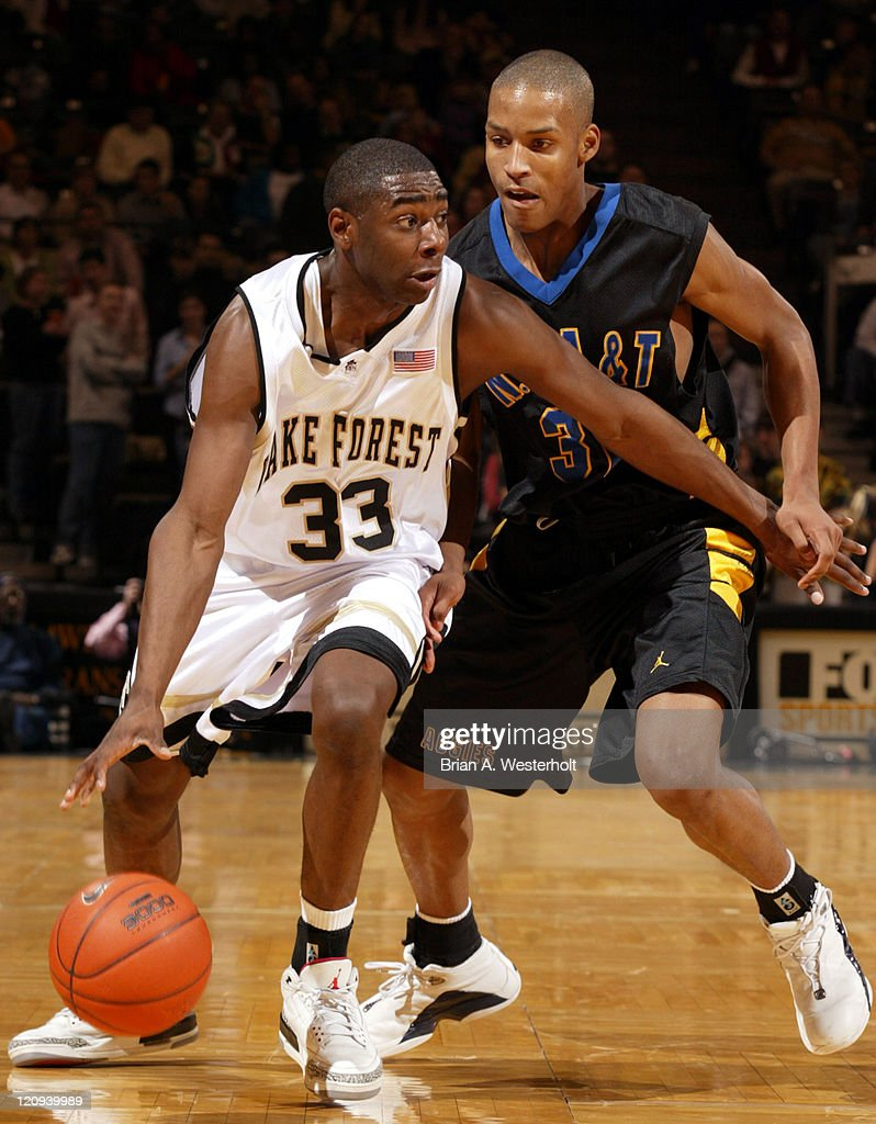 Wake Forest guard Trent Strickland drives past North Carolina AT forward Greg Roberts during second half action The Demon Deacons defeated the Aggies...