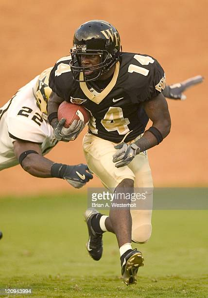 Wake Forest kick returner Kevin Marion tries to avoid the tackle of Cassen JacksonGarrison of Vanderbilt on the opening kickoff at Groves Stadium in...