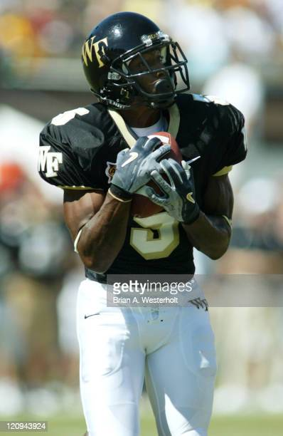Wake Forest wide receiver Chris Davis hauls in a 53yard touchdown pass from wide receiver Nate Morton during second quarter action on September 25...