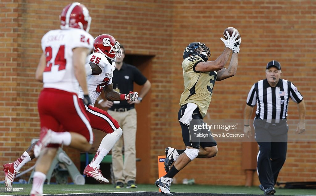 Wake Forest wide receiver Michael Campanaro (3) makes a 27-yard touchdown reception as North Carolina State cornerback Dontae Johnson (25) trails in the fourth quarter at BB&T Field in Winston-Salem, North Carolina, on Saturday, October 5, 2013. Wake Forest won, 28-13.