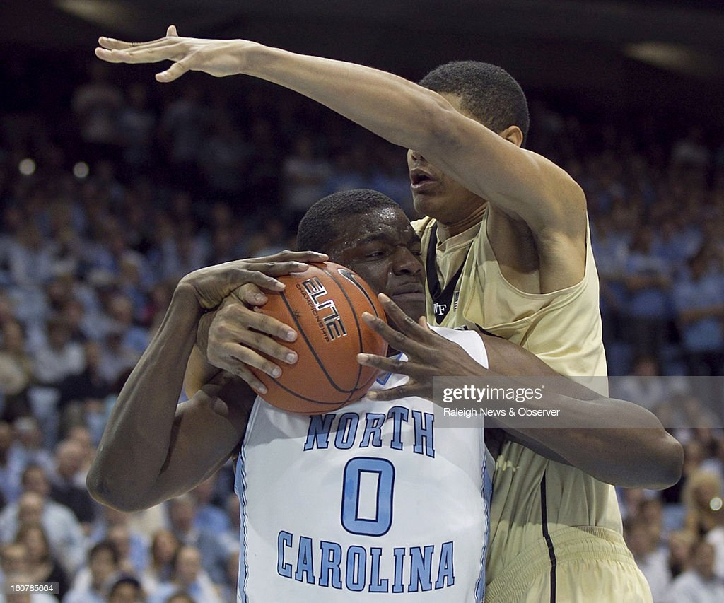 Wake Forest's Andre Washington (31) battles for a rebound with North Carolina's Joel James (0) during the second half at the Smith Center in Chapel Hill, North Carolina, Tuesday, February 5, 2013.