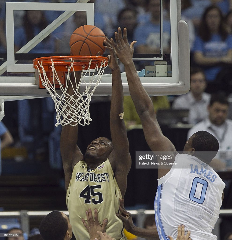 Wake Forest's Arnaud William Adala Moto (45) dunks over North Carolina's Joel James (0) during first-half action at the Smith Center in Chapel Hill, North Carolina, Tuesday, February 5, 2013.