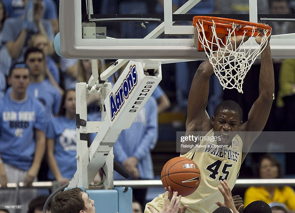 Wake Forest's Arnaud William Adala Moto (45) lets out a yell after a dunk over North Carolina's Joel James (0) during the first half at the Smith Center in Chapel Hill, North Carolina, Tuesday, February 5, 2013.