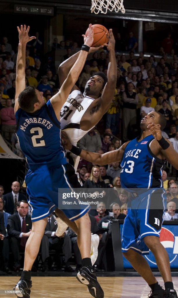Wake Forest's Eric Williams (#31) shoots over Duke's Josh McRoberts (#2) during first half action at the LJVM Coliseum in Winston-Salem, NC, Sunday January 8, 2006. Williams finished with 17 points and 8 rebounds in the 82-64 loss.