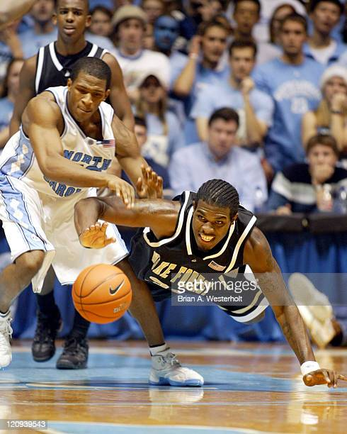 Wake Forst center Eric Williams dives for a loose ball in front of North Carolina forward Rashad McCants The Demon Deacons went on to defeat the Tar...