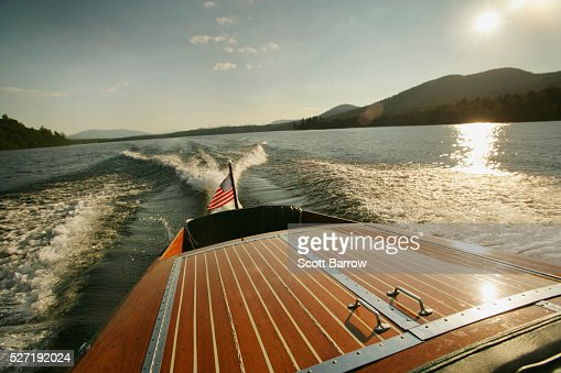 Wake of wooden inboard motorboat on a lake : Photo
