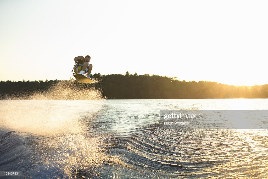 Wakeboarder at sunset : Stock Photo