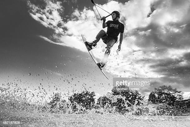 Wakeboarder Maro Schmidt performs during a training session at 'Hotspot Seepark' on July 27 2015 in Niederweimar Germany