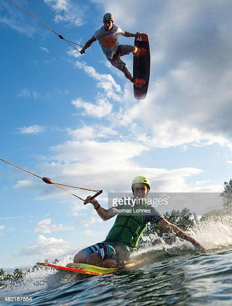 Wakeboarder Moritz Petri and Cedric Schmidt with the Kneeboard perform during a training session at 'Hotspot Seepark' on July 27 2015 in Niederweimar...