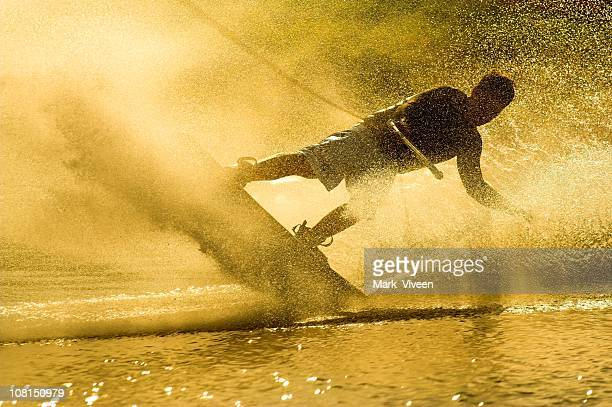 Wakeboarder on Lake at Sunset