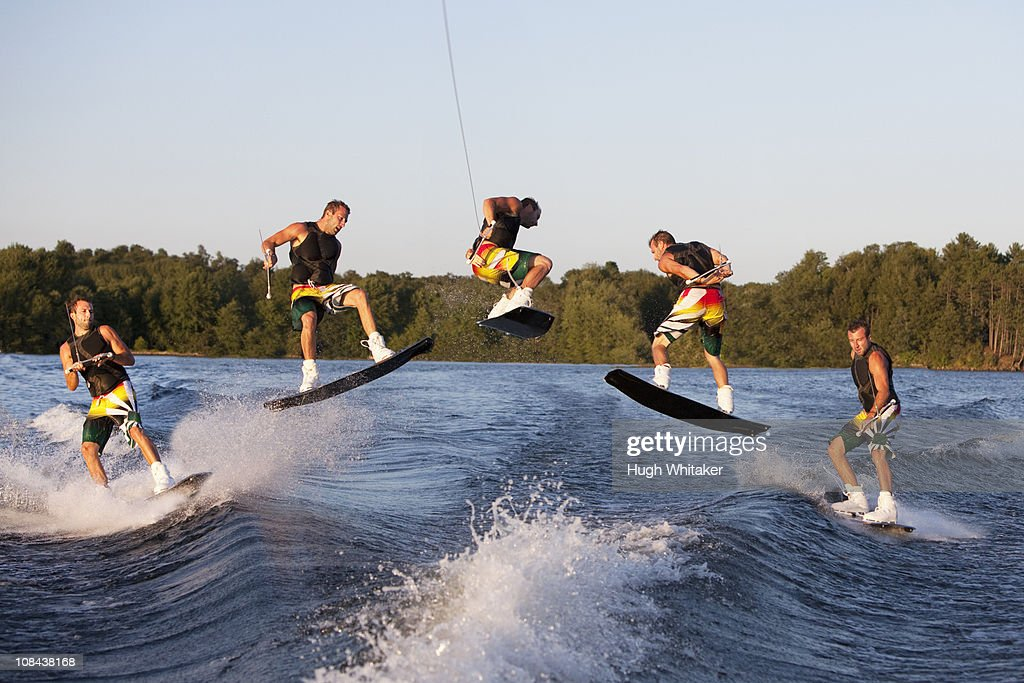 Wakeboarder performing 360 trick : Stock Photo