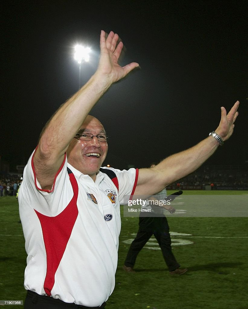 Wakefield coach John Kear celebrates after his team secured Superleague survival following their victory during the Superleague match between...
