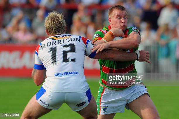 Wakefield Trinity Wildcats' Glenn Morrison tackles Warrington Wolves' Mike Cooper