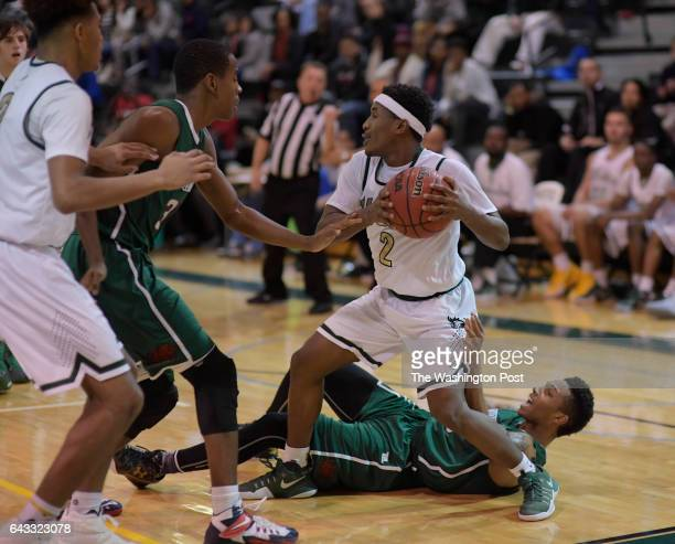 Wakefield's Alan Treakle right top matinees control of the ball against Glenelg Country's CJ Wilson right bottom and Jalen Gabbidon center left...