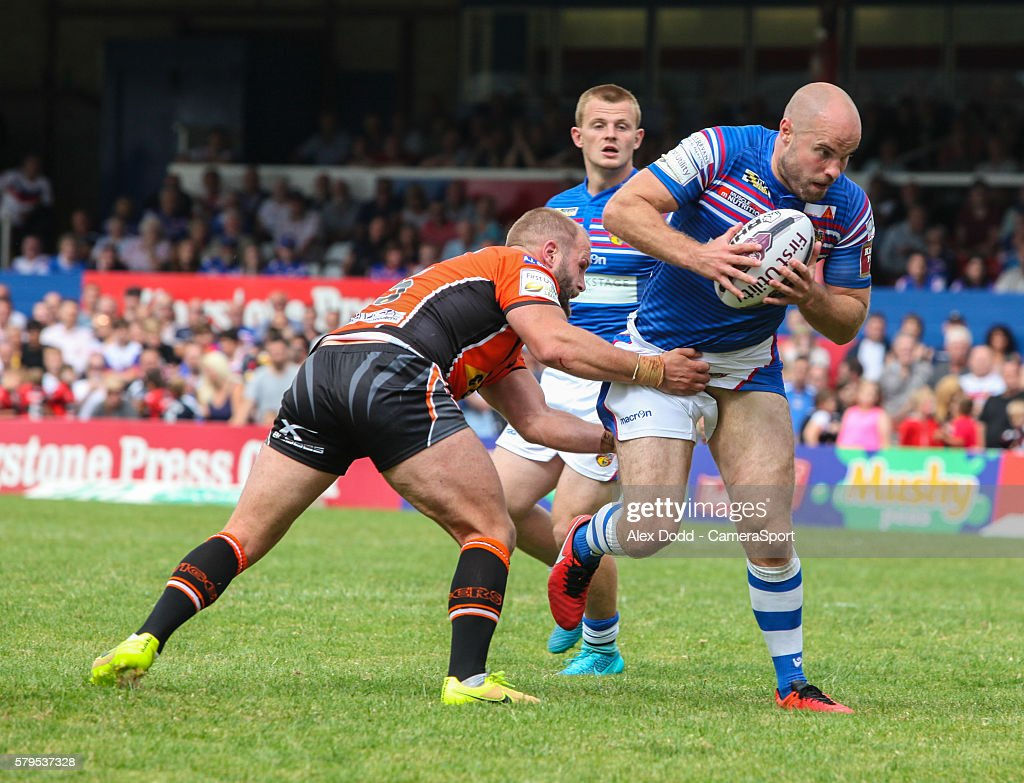 Wakefield's Liam Finn tries to get away from Castleford's Paul McShane during the First Utility Super League Round 23 match between Wakefield Trinity Wildcats and Castleford Tigers at the The Rapid Solicitors Stadium on July 24, 2016 in Wakefield, England.
