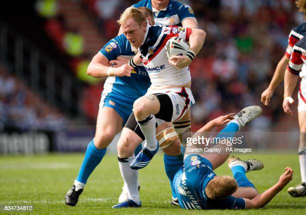 Wakefield's Paul Reilly breaks the tackles of Hull FC's Danny Tickle and Danny Washbrook during the Carnegie Challenge Cup Semi Final at the Keepmoat...