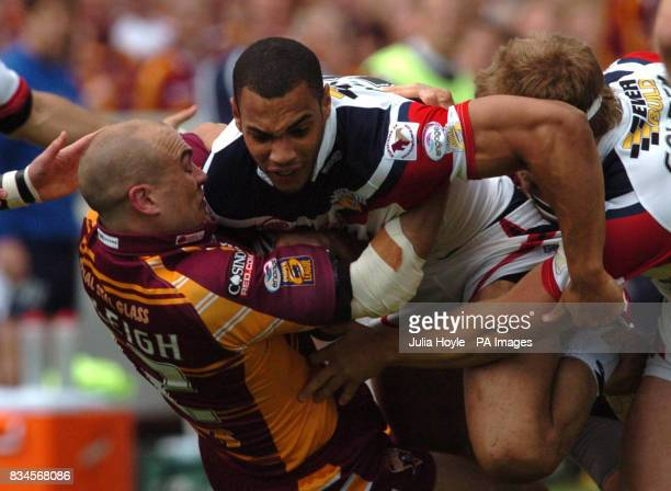 Wakefield's Ryan Atkins is tackled by Huddersfield's Andy Raleigh during the engage Super League match at Belle Vue Stadium Wakefield