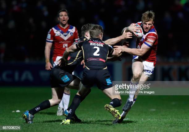 Wakefield's Tom Johnstone looks to get away from Leigh Centurions' Adam Higson during the Betfred Super League match at Belle Vue Wakefield