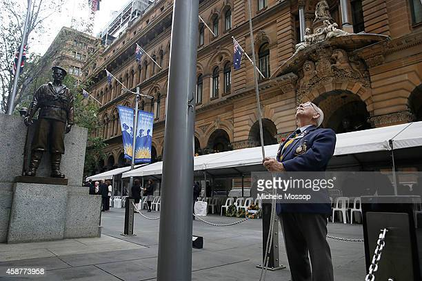 Wal ScottSmith raises the flag in preparation for tthe Remembrance Day Service held at the Cenotaph Martin Place on November 11 2014 in Sydney...