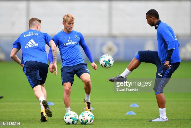 Walace controls the ball as Andre Hahn and Lewis Holtby look on during a training session of Hamburger SV on August 31 2017 in Hamburg Germany
