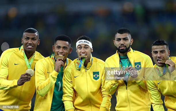 Walace of Brazil Gabriel Jesus of Brazil Neymar of Brazil Gabriel Barbosa of Brazil and Rafinha of Brazil celebrate with their gold medals following...