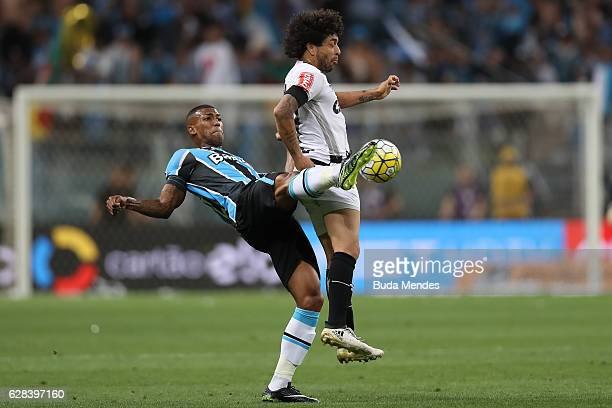 Walace of Gremio struggles for the ball with Luan of Atletico MG during a match between Gremio and Atletico MG as part of Copa do Brasil Final 2016...