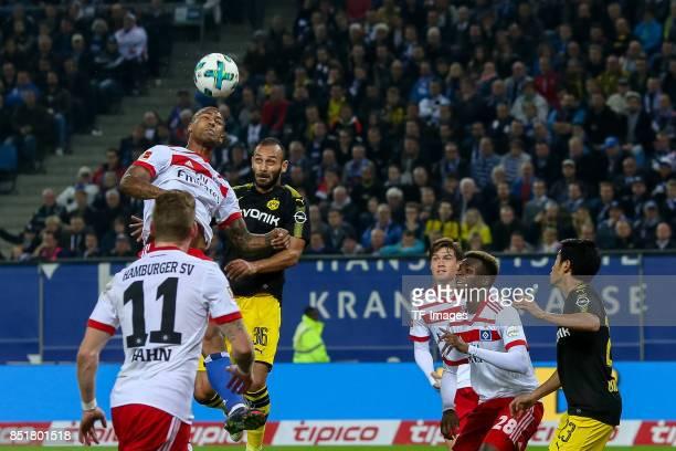 Walace of Hamburg and Oemer Toprak of Dortmund battle for the ball during the Bundesliga match between Hamburger SV and Borussia Dortmund at...
